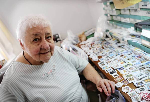 Emma Zaiac, 90, and others have collected, sorted and sold enough stamps to enable Habitat for Humanity to construct three homes.