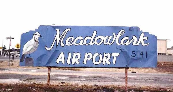 The original entrance sign for Meadowlark Airport.