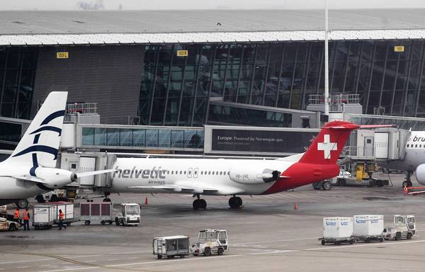 A Helvetic Airways jetliner remains on the tarmac at Brussels' international airport after armed robbers stole a shipment of diamonds that had just been loaded into the hold