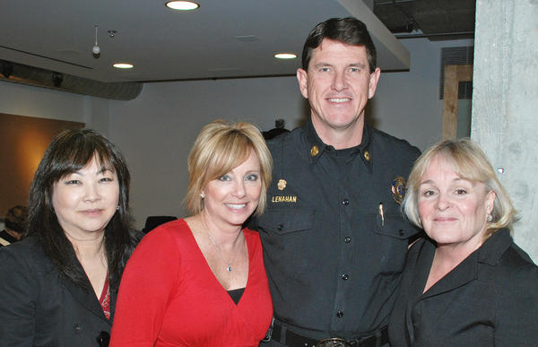 Newly sworn-in fire chief, Tom Lenahan, was joined by, from left, Dale Gorman, Ginny Goodwin and Laurie Bleik to receive the Valentine's Day love shown by Cartoon Network.