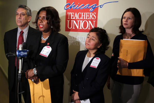 Coalition To Save Our Union officers (left to right) Mark Ochoa (vice-president), Tanya Saunders-Wolffe (president), Mary Ellen Sanchez (recording secretary, and Kelly McFarlane (financial secretary) speak to the media at Chicago Teachers Union headquarters to announce the their organization to challenge current Chicago Teachers Union President Karen Lewis.