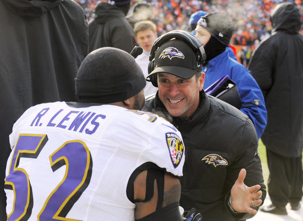 Ravens coach John Harbaugh talks with linebacker Ray Lewis on the sidelines of the AFC divisional game vs. the Broncos in January.