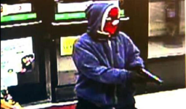 Surveillance photo of a man robbing a Northwest Side convenience store.