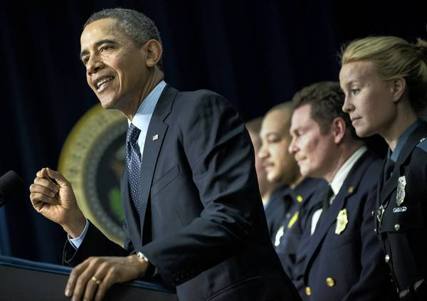 "President Obama appears at the White House with firefighters and police officers, who are among those who would be affected if scheduled spending cuts go into effect March 1. ""These cuts are not smart. They are not fair. They will hurt our economy,"" Obama said."