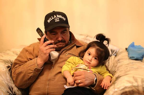 Vicente Chavez holds his 18-month-old niece, Alma Mia Zizumbo, Tuesday at the Chavez home in Chicago's Pilsen neighborhood. Baby Alma was named for Vicente's sister, Alma Chavez, who was killed in 2000. She's the daughter of Fabiola Zizumbo, sister of Alma Chavez.