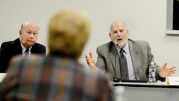 Hagerstown City Councilman Lewis C. Metzner, right, directs his answer to Washington County Board of Education member Jacqueline Fischer during a joint meeting Tuesday at the school system's central office complex off Commonwealth Avenue in Hagerstown. Looking on is Councilman Donald Munson.