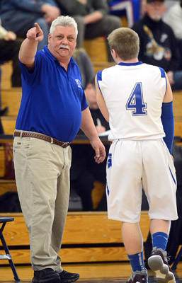 Southern Lehigh's head coach Bob Shaffer (left) talks to Dylan Schmidt (right) during their District 11 3A boys basketball tournament game with Lehighton High School Tuesday night.
