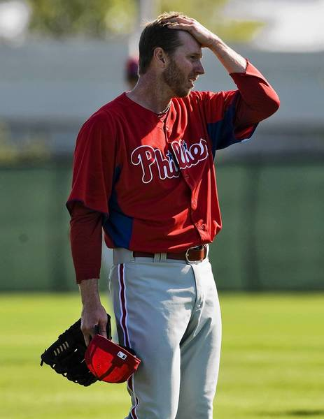 Philadelphia Phillies pitcher Roy Halladay wipes his head during a workout at the team's MLB spring training in Clearwater, Florida, February 19, 2013.