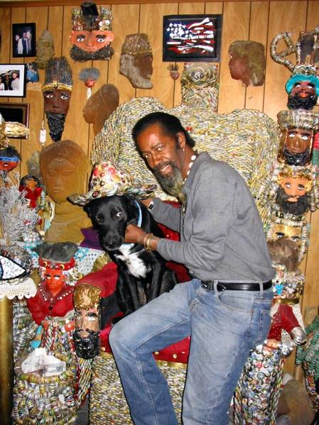 In happy times in Bethlehem, Mr. Imagination Gregory Warmack at his home with his dog Pharoah.