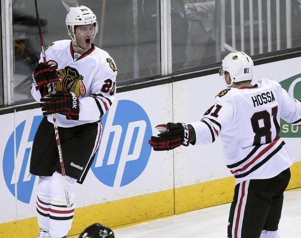 Win: Blackhawks 5, Sharks 3 -- Blackhawks left wing Brandon Saad celebrates with teammate Marian Hossa after scoring a goal against the San Jose Sharks during the first period at HP Pavilion.