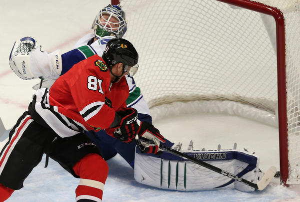 Win in shootout: Blackhawks 4, Canucks 3 -- Chicago Blackhawks right wing Marian Hossa scores his second goal of the second period against goalie Cory Schneider of the Vancouver Canucks at the United Center, in Chicago.