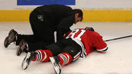 Hawks' Hossa leaves after hit to the head
