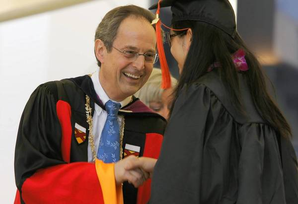 Dr. Jean–Lou Chameau congratulates a graduate in 2007. He led Caltech for seven years, raising $900 million in donations and bringing the school's endowment to $1.9 billion.
