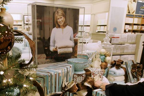 A sales associate arranges Martha Stewart products at a Macy's store in Cincinnati in 2007.