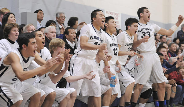 Flintridge Prep's bench reacts during the fourth quarter of their CIF Southern Section Division V-AA quarterfinal boys' basketball playoff game against Santa Clara at Flintridge Preparatory High School on Tuesday, Feb. 19, 2013 in La Canada, Calif.  Flintridge Prep won 77-74.