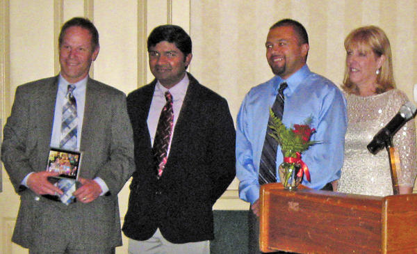 Todd Bowman, left, president of Bowman Trailer Leasing, is honored Feb. 9 at Walnut Street Community Health Center's annual Sweetheart Gala at Fountain Head Country Club in Hagerstown. With Bowman, from left, are Dr. Ilaya Rajagopal, director of the centers dental practice; Earl Stoner, president of the center's board of directors; and Kim Murdaugh, executive director of the center.