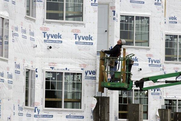 Housing starts dropped last month but remained solidly above year-ago levels. A construction worker at a new home under construction in Chicago.