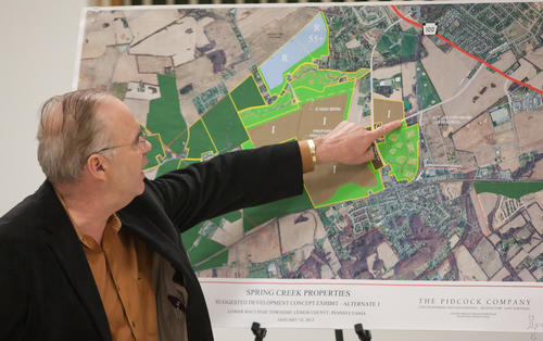 "David Jaindl held a community meeting on Tuesday at the Lower Macungie Community Center to brief local home owners on his new proposal which calls for smaller industrial use, lower numbers of residential units and more preserved and recreational space. The revised proposal for 700 acres (Plan ""B"") owned by the Jaindl Land company in Lower Macungie Township."