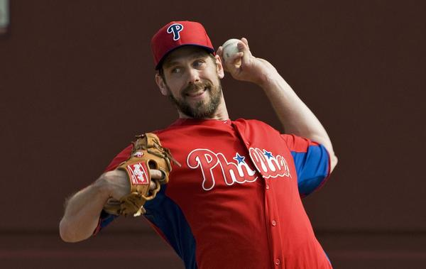 Philadelphia Phillies pitcher Cliff Lee throws in the bullpen during a workout at the team's MLB spring training in Clearwater, Florida, February 19, 2013.