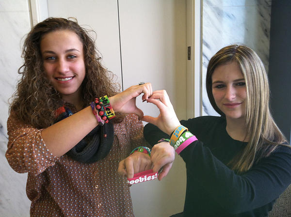 Brianna Hawk (left), 15, and Kayla Martinez (right), 14, display their 'I (heart) Boobies!' bracelets.
