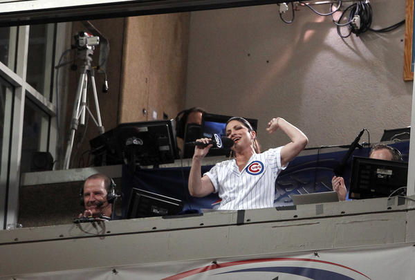 Singer Gloria Estefan sings during the seventh-inning stretch at a Cubs game at Wrigley Field on July 30, 2012.