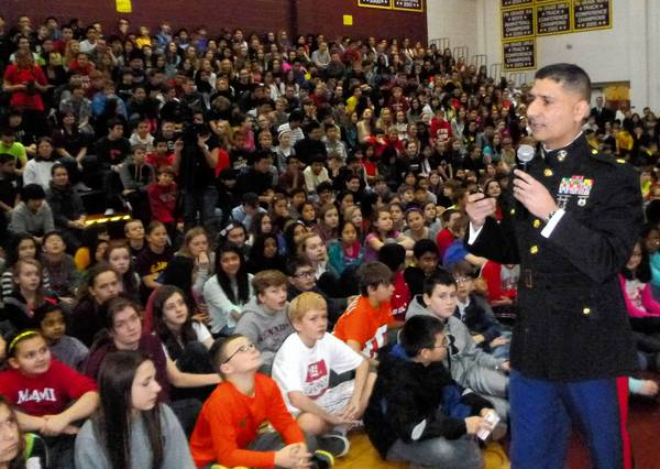 Decorated Marine Guillermo Rosales speaks to students at Kennedy Junior High School in Lisle.