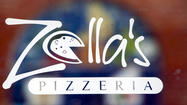 The original owners of Zella's Pizzeria on Hollins Street are coming back.