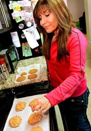 Lisa Lillien checks peanut butter oatmeal cookies.