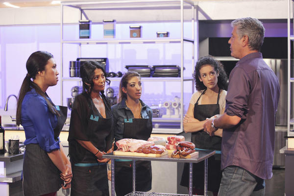 "Anthony Bourdain, right, talks to his team on ""The Taste."""