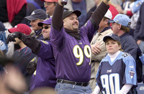 Ravens fans celebrate the 24-10 win over the Titans at Adelphia Stadium.