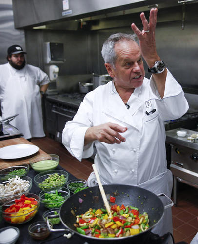 "Wolfgang Puck addresses his assistant for the day, Los Angeles Times staff writer John Horn, while preparing dishes from the menu for the 2013 Academy Awards Governors Ball.  <style type=""text/css"">