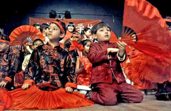 Students perform a Chinese Fan Dance during the Foothill Chinese School's 2013 Chinese New Year Party at the Community Center of La Cañada Flintridge.