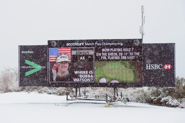 Snow surrounds a display board at the Accenture Match Play Championship