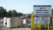 "The conflict over the Westgate subdivision has made it to a federal courthouse with the filing of a lawsuit by R. J. Corman Real Estate alleging the city of Nicholasville has violated the federal ""Clean Water Act"" in allowing storm water discharge from the development to enter Jessamine Creek."