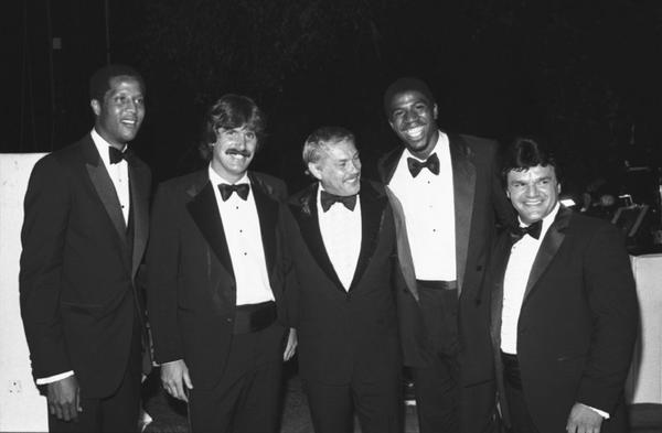 Jerry Buss, center, is joined at a 1980 event by a mix of Lakers and Kings, including Jamaal Wilkes, from left, Charlie Simmer, Magic Johnson and Marcel Dionne.