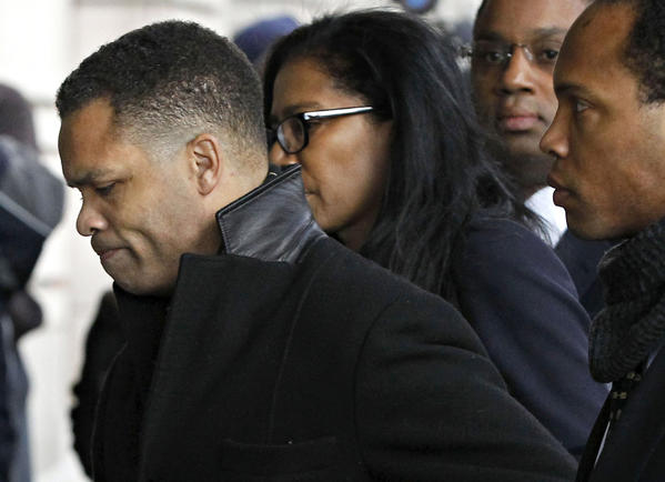 Jesse Jackson Jr., accompanied by his brothers Yusef, right, and Jonathan, second right, and crisis communications spokeswoman Judy Smith arrives at U.S. District Court in Washington, D.C.