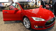 Tesla posts revenue of $306 million, larger-than-expected loss