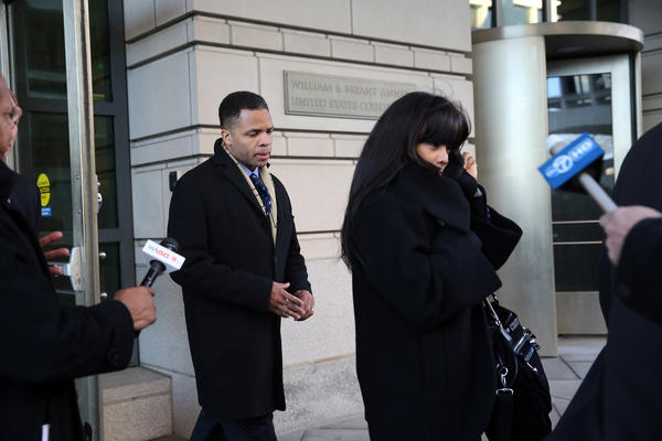 Jesse Jackson Jr. and his wife Sandi Jackson leave federal court in Washington, D.C., after pleading guilty.