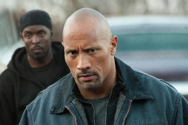 "Dwayne Johnson stars in ""Snitch."""