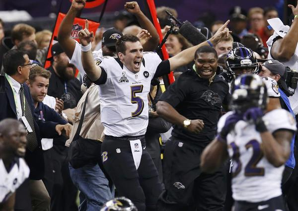Ravens quarterback Joe Flacco runs onto the field after the Super Bowl victory.