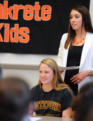 Megan Tiwold, a Northampton High School student, will play Field Hockey at St. Joseph's University next year. Her coach, Kelly Backenstoe, talks about her accomplishments at a signing ceremony held in the high school's library on Wednesday.