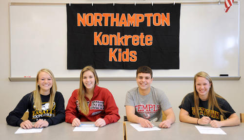 (L to R) Tori Gollie will play softball at LaSalle University; Emily Nonnemacher will play field Hockey at St. Joseph's University; Evan Notaro, will play Golf at Temple University and Megan Tiwold will play Field Hockey at Kutztown University. They attend a signing ceremony at the high school's library on Wednesday.
