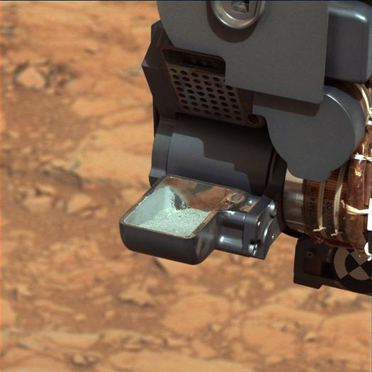 Curiosity scoop of drilled rock on Mars