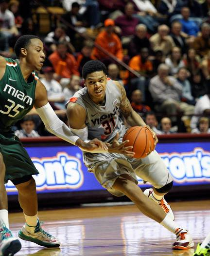 Virginia Tech's Jarell Eddie drives against Miami