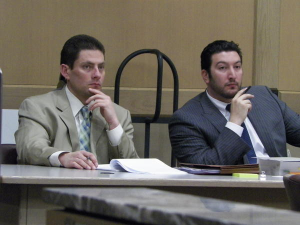 Suspended Broward Sheriff's Deputy Brent Wooddell, left, with defense lawyer Alan Grinberg.