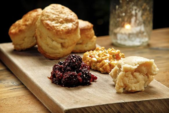 Butter biscuits served with  mashed blackberries, pimento cheese spread and honey butter.