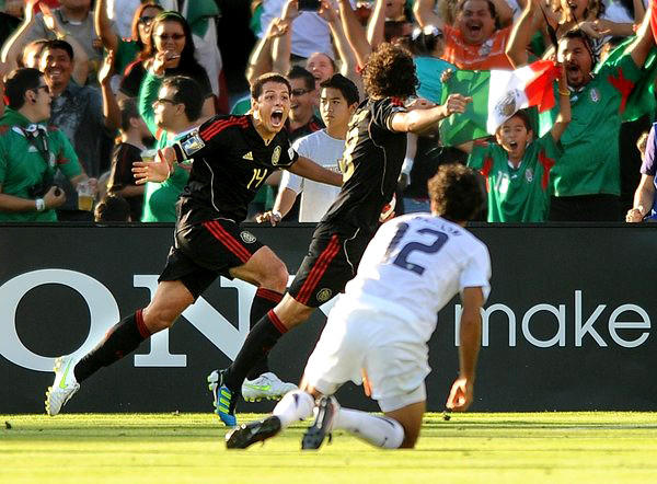 Mexico's Javier Hernandez, left, celebrates with Andres Guardado after he scored against Jonathan Bornstein (12) and the U.S. in the 2011 Gold Cup championship match at the Rose Bowl.
