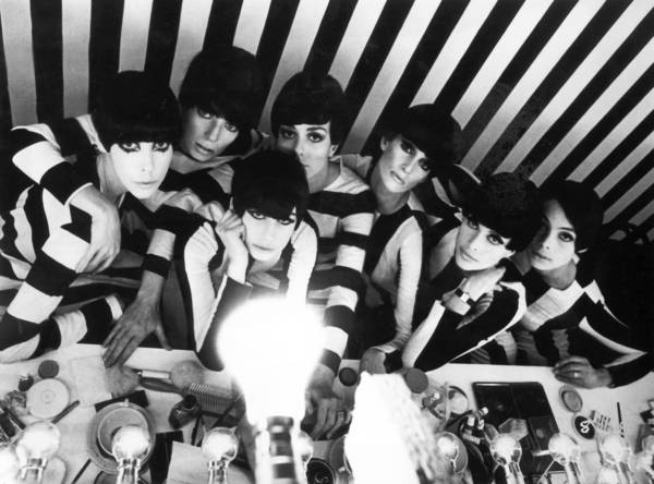 "Model Peggy Moffitt, far left, appears in an image that seems a distillation of the 1960s, from the William Klein film ""Who Are You, Polly Maggoo?"""