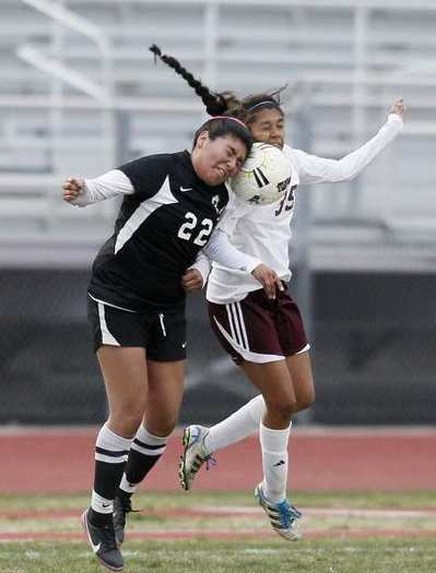 Ocean View's Cintia Ruiz, right, goes up for a header against Pacifica's Jenny Rodriguez during a CIF Southern Section Division 6 second-round playoff game on Tuesday.