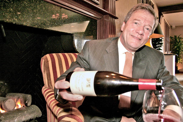 Celebrity sommelier and PinotFest host George Skorka enjoys wine by the fireplace at the Altadena Town & Country Club.